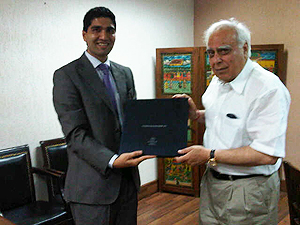 Presenting the FES book to Kapil Sibal